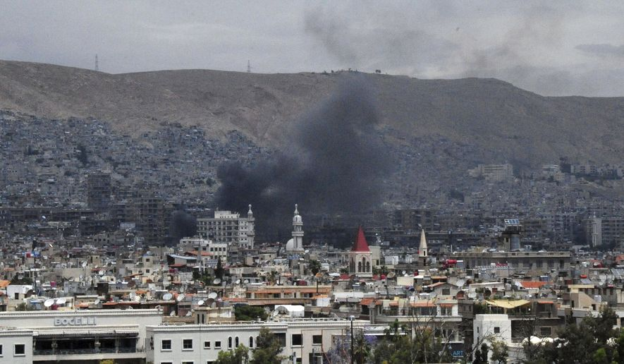 In this photo released by the Syrian official news agency SANA, smoke rises after shelling, apparently by Islamic State fighters, in Damascus, Syria, Wednesday, May 9, 2018. Militants fired three mortar shells on the center of Damascus Wednesday killing several persons and wounding 14, Syria's state news agency said. (SANA via AP)