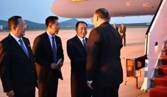 Secretary of State Mike Pompeo bids farewell to senior North Korean official Kim Yong Chul, director of the United Front Department, which is responsible for North-South Korea affairs, right, and Foreign Minister Ri Su Yong, left, on his departure from Pyongyang, North Korea, Wednesday, May 9, 2018. Pompeo met with North Korean leader Kim Jong Il earlier and secured the release of three American prisoners ahead of a planned summit between Kim and President Donald Trump. Translator in center.  (AP Photo/Matthew Lee, Pool)