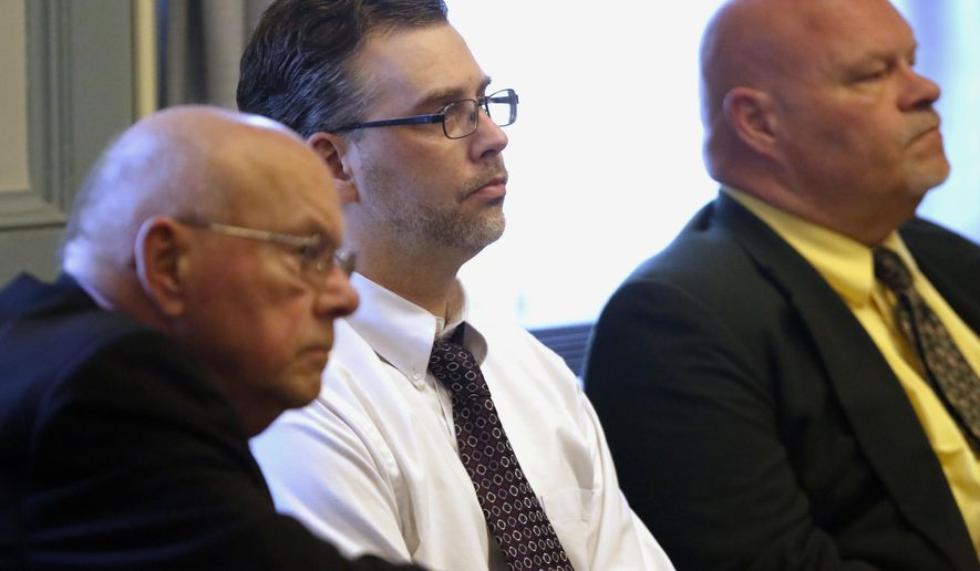 Shawn Grate, center, sits between his attorneys Robert, left, and Rolf Whitney before Judge Ronald P. Forsthoefel during a trial  in Ashland, Ohio, Monday, May 7, 2018. Grate was convicted Monday in the slayings of two women whose bodies were found underneath piles of clothes in what was thought to be a vacant Ohio home. (Tom E. Puskar/The Times Gazette via AP)
