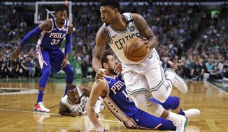Boston Celtics guard Marcus Smart, right, drives past Philadelphia 76ers guard Marco Belinelli during the first quarter of Game 5 of an NBA basketball playoff series in Boston, Wednesday, May 9, 2018. (AP Photo/Charles Krupa)