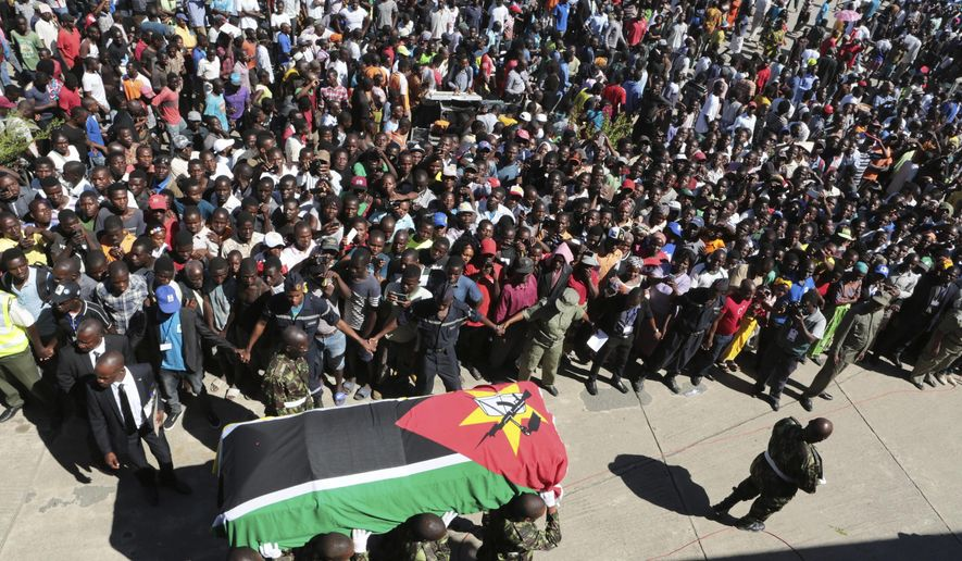 Soldiers carry the coffin of Mozambique's opposition leader, Alfonso Dhlakama during his state funeral in Beira about 700 kilometres south of the capital Maputo, Wednesday, May, 9, 2018. Dhlakama, who led a rebel group during the devastating civil war that ended in 1992 died on May 3. He was 65.  (AP Photo/Tsvangirayi Mukwazhi)