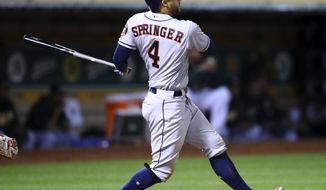 Houston Astros' George Springer watches his two run double hit off Oakland Athletics' Sean Manaea in the fifth of a baseball game Tuesday, May 8, 2018, in Oakland, Calif. (AP Photo/Ben Margot)