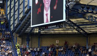 A tribute to Sir Alex Ferguson is displayed as the former Manchester United manager remains in intensive medical care, during the English Premier League soccer match between Chelsea and Liverpool at Stamford Bridge in London, Sunday May 6, 2018. Manchester United said Saturday May 5, that former manager Alex Ferguson has undergone emergency surgery for a brain haemorrhage. (Dominic Lipinski/PA via AP)