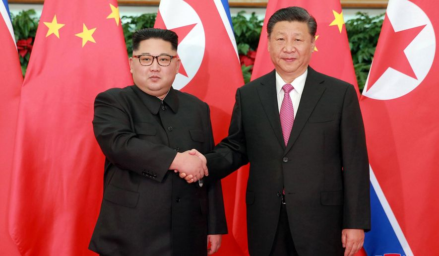 """In this May 7, 2018, photo provided by the North Korean government, North Korean leader Kim Jong Un, left, meets Chinese President Xi Jinping in Dalian, China. Independent journalists were not given access to cover the event depicted in this image distributed by the North Korean government. The content of this image is as provided and cannot be independently verified. Korean language watermark on image as provided by source reads: """"KCNA"""" which is the abbreviation for Korean Central News Agency. (Korean Central News Agency/Korea News Service via AP)"""