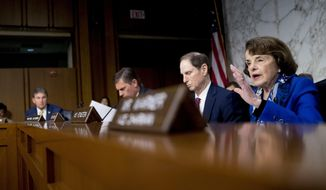Sen. Dianne Feinstein, D-Calif., right, questions Gina Haspel, President Donald Trump's pick to lead the Central Intelligence Agency, as she testifies at her confirmation hearing before the Senate Intelligence Committee, on Capitol Hill, Wednesday, May 9, 2018, in Washington. (AP Photo/Andrew Harnik)