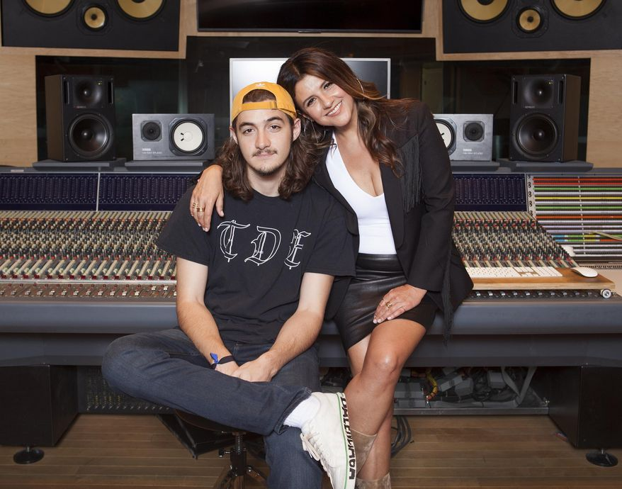 In this May 4, 2018 photo, Deacon Frey, son of the late Eagles co-founder Glenn Frey, left, and his mother Cindy Frey pose for a portrait at Dog House Recording Studio in Los Angeles. Deacon Frey is keeping his dad's legacy alive by touring and performing with the Eagles. Cindy Frey, is the executor of her husband's estate. (Photo by Rebecca Cabage/Invision/AP)