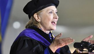 FILE - In this May 26, 2017, file photo, former Secretary of State Hillary Clinton delivers the commencement address at Wellesley College in Wellesley, Mass. Clinton is scheduled to be the speaker at Yale's class day on Sunday, May 20, 2018. An Associated Press analysis found that two-thirds of the speakers at the nation's 25 wealthiest colleges' ceremonies in spring 2018 are women for the first time in at least two decades. (AP Photo/Josh Reynolds, File)