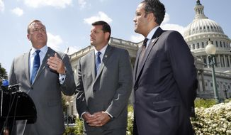 Rep. Jeff Denham, R-Calif., left, speaks next to Rep. David Valadao, R-Calif., and Rep. Will Hurd, R-Texas, during a news conference with House Republicans who are collecting signatures on a petition to force House votes on immigration legislation, Wednesday, May 9, 2018, on Capitol Hill in Washington. (AP Photo/Jacquelyn Martin)