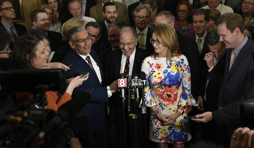 State Democratic President Pro Tempore Martin M. Looney D-New Haven, laughs as Senate Republican President Pro Tempore Len Fasano, R-North Haven, left, and House Minority Leader Themis Klarides, R-Derby, right, look on, during a news conference to announce a bipartisan on the state's budget at the State Capital, Wednesday, May 9, 2018, in Hartford, Conn. (AP Photo/Jessica Hill)