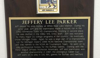 In a May 3, 2018 photo, a plaque at Chippewa Area Ice Arena in Chippewa Falls, Wis., honors former NHL player Jeff Parker, brother of Chippewa Falls High School boys hockey coach Scott Parker. Jeff was a volunteer assistant coach for the Chi-Hi team during the 1993-94 season. (Eric Lindquist/The Eau Claire Leader-Telegram via AP)