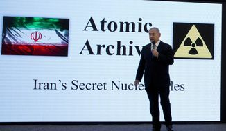 FILE - In this Monday, April 30 2018 file photo, Israeli Prime Minister Benjamin Netanyahu presents material on Iran's purported nuclear program in Tel Aviv. Iran's rivals long have wanted to scuttle the nuclear deal with world powers, but its destruction could backfire and spark even more unrest in parts of the Middle East as Saudi Arabia threatens to launch its own nuclear weapons program in response. (AP Photo/Sebastian Scheiner, File)