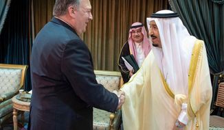 FILE- In this Sunday, April 29, 2018 file photo released by Saudi Press Agency, SPA, U.S. Secretary of State Mike Pompeo, left, is greeted by Saudi King Salman in Riyadh, Saudi Arabia. Iran's rivals long have wanted to scuttle the nuclear deal with world powers, but its destruction could backfire and spark even more unrest in parts of the Middle East as Saudi Arabia threatens to launch its own nuclear weapons program in response. (Saudi Press Agency via AP)