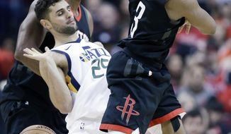Houston Rockets guard Chris Paul, right, is fouled by Utah Jazz guard Raul Neto during the second half in Game 5 of an NBA basketball second-round playoff series, Tuesday, May 8, 2018, in Houston. (AP Photo/Eric Christian Smith)