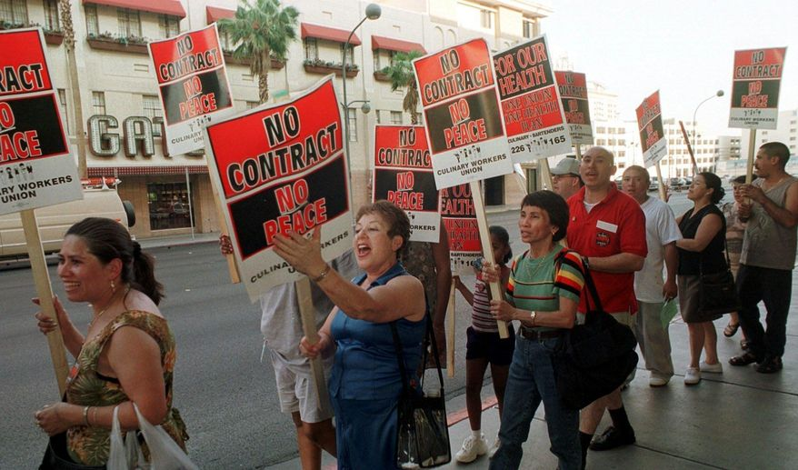 FILE - In this June 30, 2002 file photo, members of the Culinary Union Local 226 picket outside the Plaza hotel-casino in Las Vegas hours before their contract was to expire. Fifty-thousand unionized Las Vegas casino workers whose contracts will expire at the end of the month are set to vote on whether to go on strike. The Culinary Union on Wednesday, May 9, 2018, said it will hold a strike vote May 22 at a university arena. (AP Photo/Lori Cain, File)