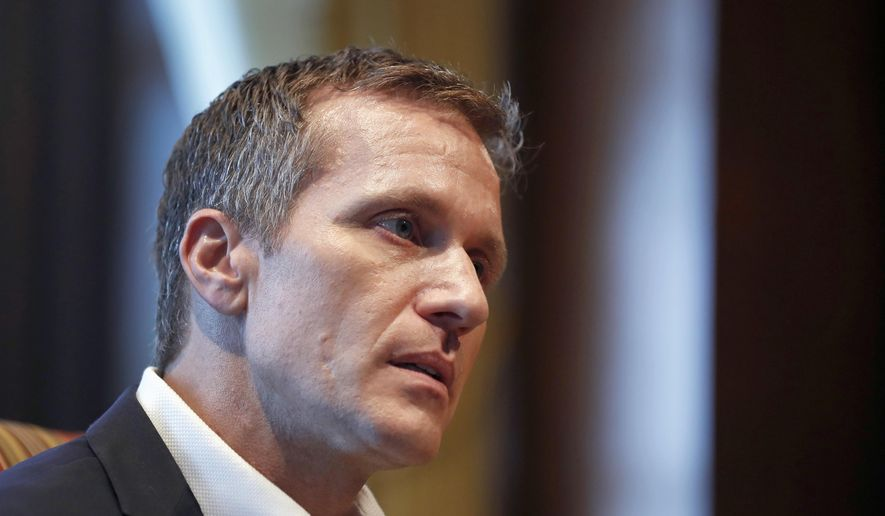 In this Jan. 20, 2018, file photo, Missouri Gov. Eric Greitens listens to a question during an interview in his office at the Capitol in Jefferson City, Mo., where discussed having an extramarital affair before taking office. Jury selection is set to begin Thursday, May 10, 2018, in Greitens' felony invasion of privacy trial. He is accused of taking an unauthorized photo of a woman while she was partially nude during a 2015 sexual encounter, before he was elected. (AP Photo/Jeff Roberson, File)