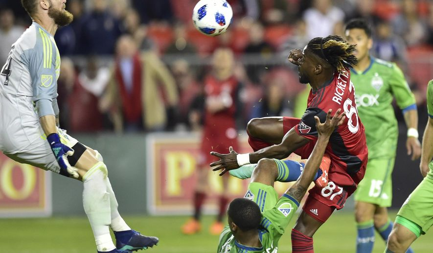 Seattle Sounders FC keeper Stefan Frei makes a save on Toronto FC forward Tosaint Ricketts during the second half of an MLS soccer match Wednesday, May 9, 2018, in Toronto. (Frank Gunn/The Canadian Press via AP)