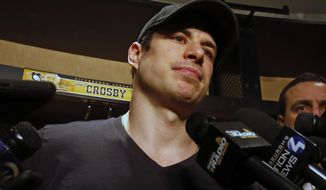 Pittsburgh Penguins' Sidney Crosby talks with media while cleaning out his locker at the NHL hockey team's training facility in Cranberry, Pa., Wednesday, May 9, 2018. (AP Photo/Gene J. Puskar)