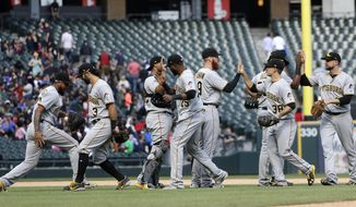The Pittsburgh Pirates celebrate the team's 6-5 win over the Chicago White Sox after a baseball game Wednesday, May 9, 2018, in Chicago. (AP Photo/Charles Rex Arbogast)