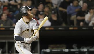 Pittsburgh Pirates' Colin Moran watches his two-run double off Chicago White Sox relief pitcher Chris Volstad during the fifth inning of a baseball game Tuesday, May 8, 2018, in Chicago. Josh Bell and Francisco Cervelli scored on the play. (AP Photo/Charles Rex Arbogast)