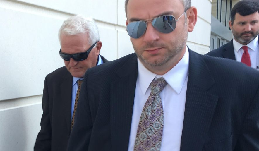 Arthur Lamar Adams, left, leaves federal court in Jackson, Miss., on Wednesday, May 9, 2018, after pleading guilty to one count of wire fraud. Federal officials say Adams ran a scheme which took in more than $100 million from more than 300 victims, including U.S. Sen. Roger Wicker. (AP Photo/Jeff Amy)