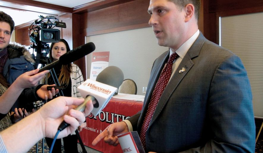 """FILE - In this Jan. 30, 2018 file photo, Wisconsin Republican senate candidate Kevin Nicholson speaks with reporters in Madison, Wis. U.S. Sen. Tammy Duckworth, of Illinois, and other Democratic veterans sent a letter Wednesday, May 9, 2018, to Nicholson calling for him to apologize for questioning the """"cognitive thought process"""" of veterans who are Democrats. Nicholson is a Marine veteran and he remains steadfast in refusing to apologize. (AP Photo/Scott Bauer, File)"""