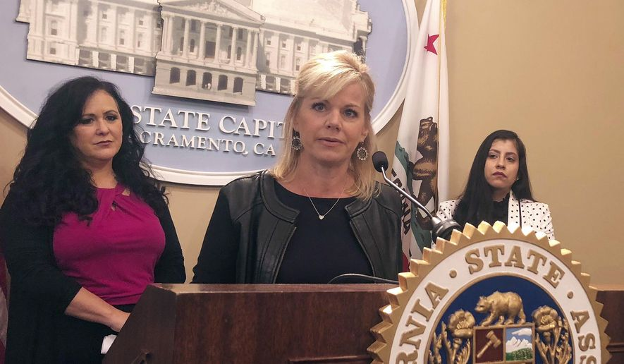 Former Fox News anchor Gretchen Carlson speaks in support of a California bill aimed at protecting workers from forced arbitration and nondisclosure agreements Wednesday, May 9, 2018, in Sacramento, Calif. The bill would bar employers from requiring forced arbitration agreements, which compel employees to settle workplace complaints instead of going to court, as a condition of employment. Listening at left is Assemblywoman Lorena Gonzalez Fletcher, D-San Diego. (AP Photo/Sophia Bollag)