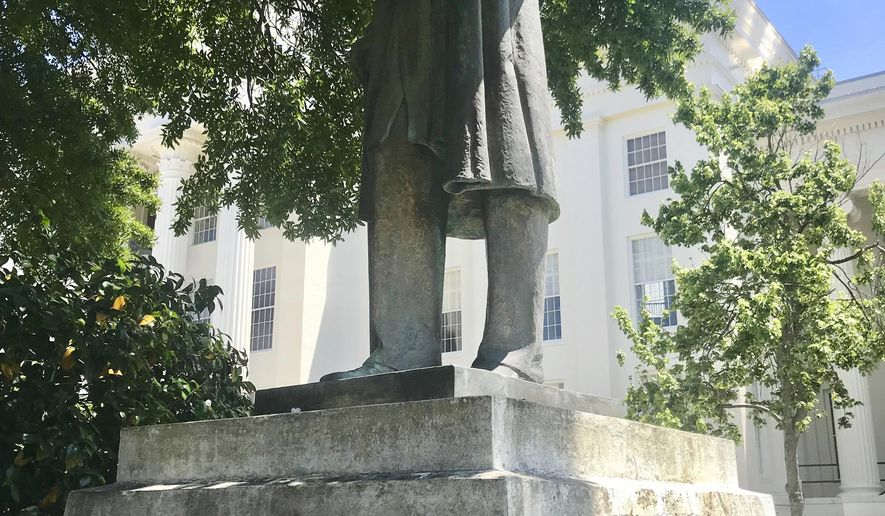 A statue of Dr. J. Marion Sims is seen, Wednesday, May, 9, 2018, on the grounds of the Alabama Capitol, in Montgomery, Ala. State Sen. Hank Sanders, and others, on Wednesday called for the state to take down the statue of Sims, a 19th century doctor who did experimental surgery without anesthesia on enslaved African-American women. (AP Photo/Kim Chandler)