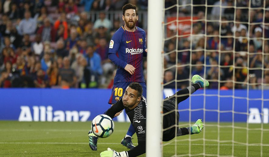 FC Barcelona's Lionel Messi kicks the ball to score during the Spanish La Liga soccer match between FC Barcelona and Villarreal at the Camp Nou stadium in Barcelona, Spain, Wednesday, May 9, 2018. (AP Photo/Manu Fernandez)