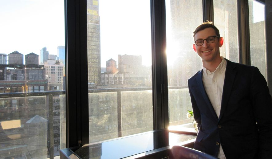 """FILE - This March 2, 2017, file photo, shows then Lonely Planet CEO Daniel Houghton at a rooftop bar in in New York. Houghton took over the venerable travel publishing company Lonely Planet at age 24 in 2013. On Tuesday, May 8, 2018, the company said Houghton """"has stepped away from Lonely Planet to take on a CEO role at another company."""" (AP Photo/Beth J. Harpaz, File)"""