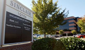 FILE - In thisOct. 12, 2004, file photo, Sinclair Broadcast Group, Inc.'s headquarters stands in Hunt Valley, Md.  Media company Twenty-First Century Fox is buying seven TV stations from Sinclair Broadcast Group for $910 million.The move comes as Sinclair is selling some stations to meet regulatory approval for its pending $3.9 billion acquisition of Tribune Media.     (AP Photo/Steve Ruark, File)
