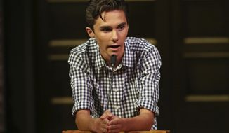 David Hogg, a student survivor from Marjory Stoneman Douglas High School in Parkland, Fla. addresses a community rally for common sense gun legislation at Temple B'nai Abraham Sunday, Feb. 25, 2018, in Livingston, N.J. Speakers include student survivors from Marjory Stoneman Douglas High School in Parkland, Fla., including Hogg, Ryan Deitsch and Matthew Deitsch. (AP Photo/Rich Schultz)
