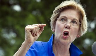 In this July 24, 2017, file photo, Sen. Elizabeth Warren, D-Mass., speaks in a park in Berryville, Va., where Congressional Democrats unveiled their new agenda. Warren is working to defuse an issue that has dogged her for years, her claims of Native American heritage, ahead of a possible run for president in 2020. (AP Photo/Cliff Owen, File)