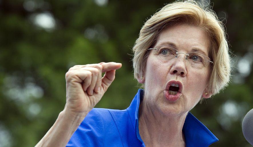 Sen. Elizabeth Warren, Massachusetts Democrat, speaks in a park in Berryville, Va., where Congressional Democrats unveiled their new agenda, on July 24, 2017. (Associated Press) **FILE**