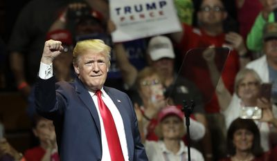 President Donald Trump acknowledges the crowd's applause during a Republican campaign rally Thursday, May 10, 2018, in Elkhart, Ind. (AP Photo/Charles Rex Arbogast)