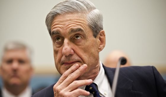 Robert Mueller's investigation team says Americans were in contact with operatives, but the indictment doesn't say any of them knew they were communicating with Russians attempting to influence the presidential election. (Associated Press/File)