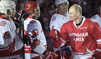 Russian President Vladimir Putin, right, takes part in a match of the Night Hockey League teams in the Bolshoy Ice Arena in the Black Sea resort of Sochi, Russia, Thursday, May 10, 2018. (Alexei Nikolsky, Sputnik/Kremlin Pool Photo via AP)
