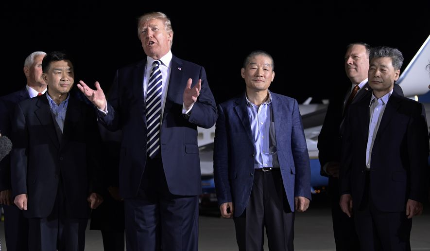 President Donald Trump speaks as he stands with Tony Kim, second left, Kim Dong-chul, center right, and Kim Hak-song, right, three Americans detained in North Korea for more than a year after they arrived at Andrews Air Force Base in Md., Thursday, May 10, 2018. Vice President Mike Pence, left, and Secretary of State Mike Pompeo, second from right, listen. (AP Photo/Susan Walsh)