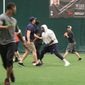 Members of the Arena Football League club Washington Valor practice in workout clothes on Thursday, May 10, 2018 at Athletic Performance Inc. in Gambrills, Md. Head coach Dean Cokinos (far right, gray shirt) watches from the sideline. (Photo by Adam Zielonka / The Washington Times)