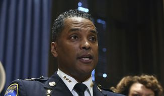 """In this  Jan. 19, 2018, file photo, Darryl De Sousa  takes questions at City Hall after replacing Kevin Davis as police commissioner, in Baltimore. DeSousa has been charged with three misdemeanor counts of failure to file taxes. The U.S. Attorney's office alleged Thursday, May 10, 2018, that  DeSousa """"willfully failed to file a federal return for tax years 2013, 2014, and 2015, despite having been a salaried employee of the Baltimore Police Department in each of those years.""""  (Kim Hairston/The Baltimore Sun via AP, File)"""