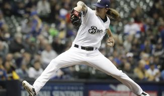 FILE - In this April 17, 2018, file photo, Milwaukee Brewers relief pitcher Josh Hader throws during the eighth inning of a baseball game against the Cincinnati Reds, in Milwaukee. A stellar April earned NL Reliever of the Month honors for Hader. The scariest part for the rest of the league is that Hader is just 24. Someday, he might be a starter. (AP Photo/Morry Gash, File)