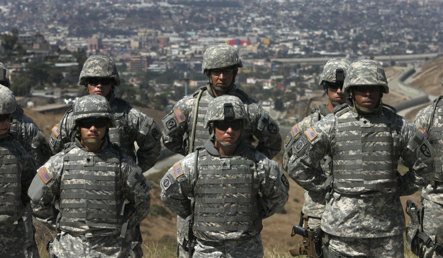 In this Aug. 18, 2010, file photo, California National Guard troops, part of Task Force Sierra, which are training for future deployment at the border along with Border Patrol Agents, stand in formation near the California/Mexico border in San Diego. California National Guard troops have started training with the U.S. Customs and Border Patrol to be camera operators, radio dispatchers, intelligence analysts and fill other support roles to free up more agents to patrol the Mexican border. (John Gibbons/San Diego Union-Tribune via AP) **FILE**