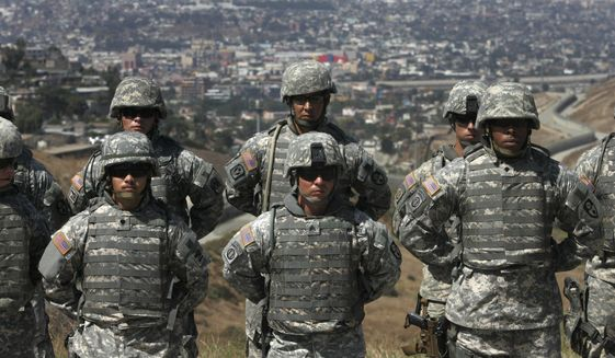 In this Aug. 18, 2010, file photo, California National Guard troops, part of Task Force Sierra, which are training for future deployment at the border along with Border Patrol Agents, stand in formation near the California/Mexico border in San Diego. (John Gibbons/San Diego Union-Tribune via AP) **FILE**