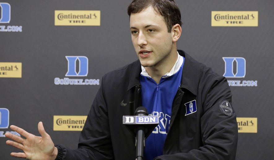 Brennan Besser speaks with members of the media on campus at Duke University in Durham, N.C., Thursday, May 10, 2018. The Duke men's basketball walk-on will spend the summer on a rather long walk _ and run and bike ride. Besser plans to bike, walk and run from Seattle to New York to raise awareness and funds for the foundation he started for charity. (AP Photo/Gerry Broome)