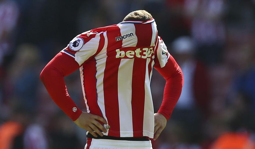 FILE - In this Saturday May 5, 2018 file photo, Stoke City's Xherdan Shaqiri reacts after Stoke City are relegated, following the English Premier League soccer match between Stoke City and Crystal Palace, at the bet365 Stadium, in Stoke, England. Stoke City, West Bromwich Albion and Swansea City used to be perennial mid-table finishers boasting some of the clearest identities in the English Premier League. Stoke and West Brom have lost their identity and already been relegated ahead of the final day of the season. Swansea could become the third relegated team on Sunday. (Dave Thompson/PA via AP, File)