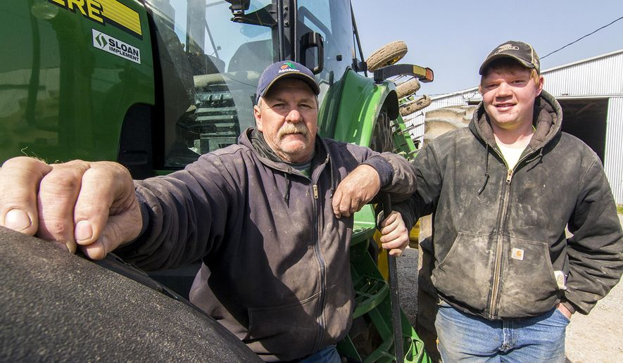 In this April 17, 2018 photo Ted Kreke, left, and his son John farm ground in Teutopolis, Ill. John  plans to take over the family farm once he finishes his studies at Lake Land College and then at Southern Illinois University in Carbondale. Over the last 30 years, family farm ownership hasn't decreased. In fact, according to a report by the USDA last year, such farms accounted for 99 percent of all U.S. farms and 89 percent of production in 2015. In spite of that trend, Kessler plan's to enter the field once they complete their degrees. (Keith Stewart/Effingham Daily News via AP)