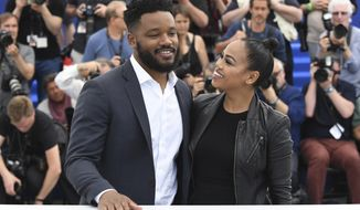 Director Ryan Coogler, left, and Zinzi Evans pose for photographers during a photo call at the 71st international film festival, Cannes, southern France, Thursday, May 10, 2018. (Photo by Arthur Mola/Invision/AP)
