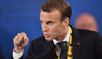 French President Emmanuel Macron speaks on occasion of the Charlemagne Prize awarding to French President Emmanuel Macron in Aachen, Germany, Thursday, May 10, 2018. (AP Photo/Martin Meissner)