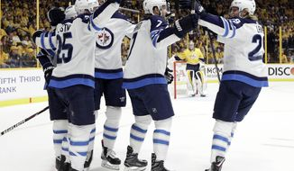 Winnipeg Jets celebrate a goal by Paul Stastny (25) against the Nashville Predators during the first period in Game 7 of an NHL hockey second-round playoff series Thursday, May 10, 2018, in Nashville, Tenn. (AP Photo/Mark Humphrey)