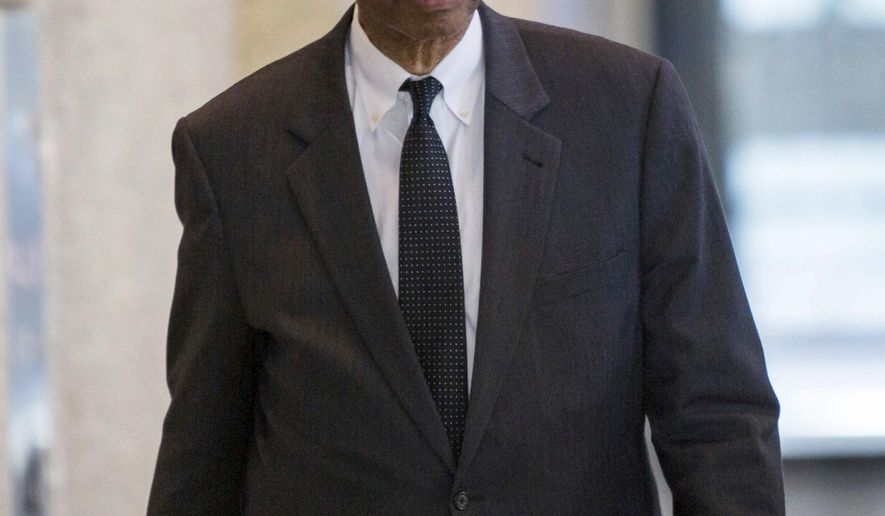 FILE - In this Sept. 28, 2017, file photo, former U.S. Rep. Mel Reynolds leaves the federal building in Chicago after he was convicted on charges he failed to file tax returns for income he made while in Africa consulting for Chicago businessmen. Reynolds is scheduled to be sentenced Thursday, May 10, 2018. (James Foster/Chicago Sun-Times via AP, File)