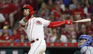 Cincinnati Reds' Eugenio Suarez watches an RBI single off New York Mets relief pitcher Hansel Robles during the seventh inning of a baseball game, Tuesday, May 8, 2018, in Cincinnati. (AP Photo/John Minchillo)